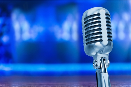 Retro microphone with pink wall background Stock Photo