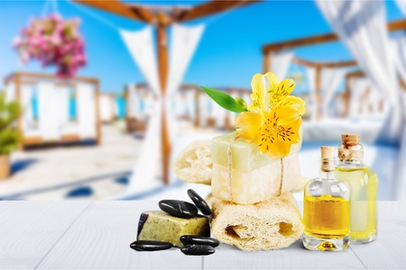 Spa still life with soap,sponge and cosmetic oil isolated on white background.
