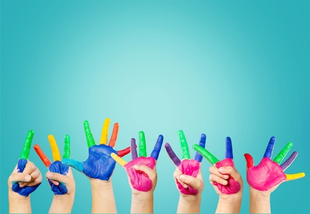 painted childrens hands in different colors with smilies Stock Photo