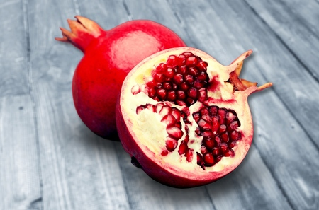 Pomegranates on wooden background