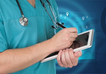 Hands of doctor using tablet computer