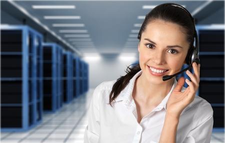 Female customer service representative smiling Stock Photo