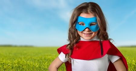Full length portrait of superhero kid against grunge wall background Stock Photo