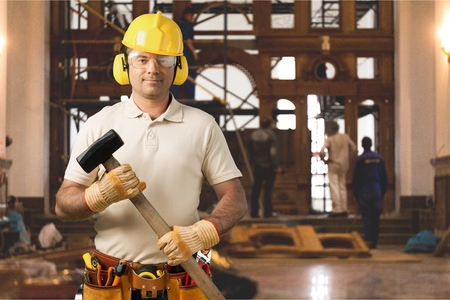 Carpenter Contractor Man Wearing Gogles Toolbelt Hardhat Isolated on White Stock Photo