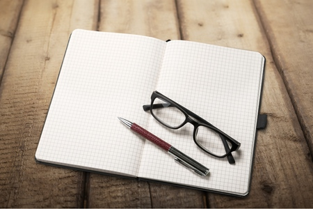 Office supplies and glasses. View from above. Isolated on white background Stock Photo