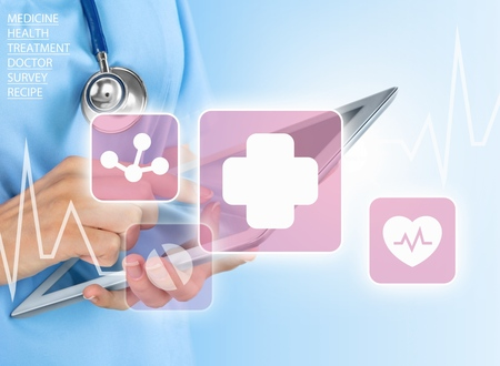 Woman doctor using tablet computer in hospital Stock Photo