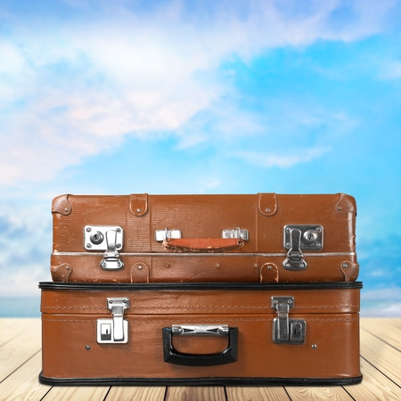 Two Vintage Suitcases Isolated with clipping path on a white background Stock Photo