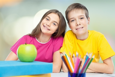 Portrait of two diligent pupils interacting while drawing at lesson Stock Photo