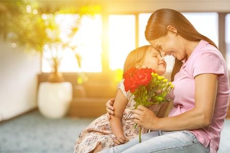 Child daughter congratulates mother