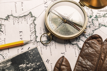 compass wallet and passport on the old map Stock Photo - 102306760
