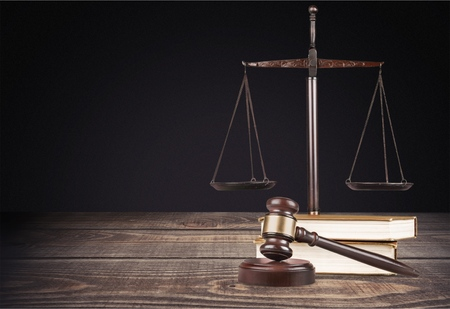 Justice Scales with books and wooden gavel Stock Photo