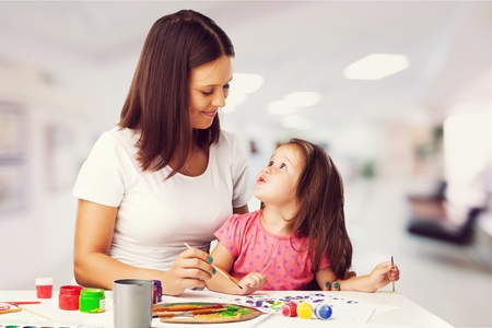 Woman and child painting