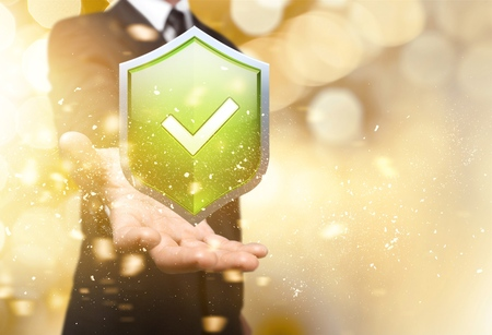 Businessman holding shield protect icon