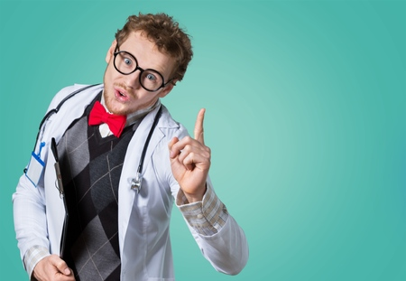 Funny doctor in glasses with notebook