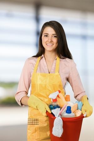 Young maid with bucketful looking at camera.