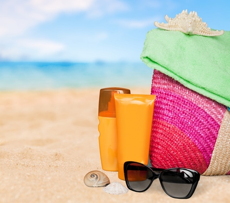 Conceptual summer fun border, beach items isolated on white background, summertime tropical vacation and travel, womens accessories for outdoor relaxation, holidays