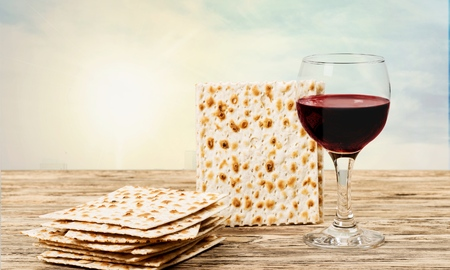 passover background. wine and matzoh (jewish passover bread) over wooden background. vintage effect process.