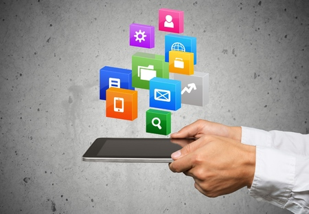 Cloud of colorful application icons in the hands of businessmen, Business software and social media networking service concept, Save paths for design work