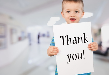 Thank you Sign Held By Happy Young Boy