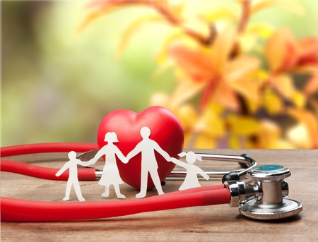 Medical Insurance Concept With Family Cut-out Foto de archivo