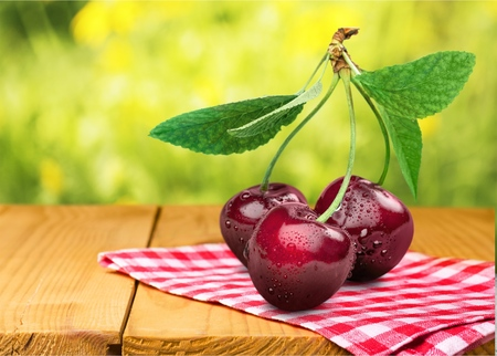 Cherry trio with stem and Leaf Stock fotó