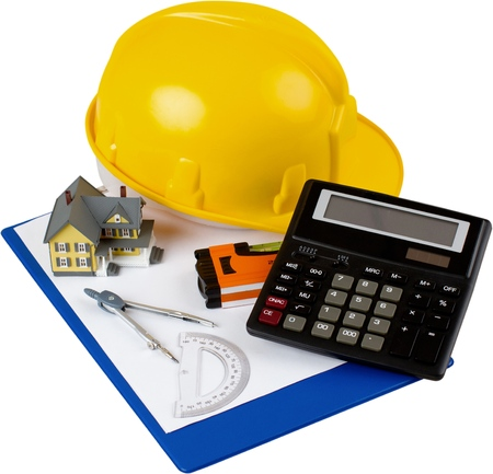 Safety Helmet, Calculator, House Model, Level, Calipers, Notepad And Protractor - Isolated Stock Photo