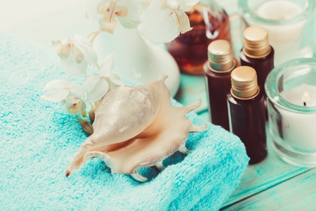 Spa and wellness setting with flowers, candles and towel. Blue dayspa nature set with copyspace Stock Photo