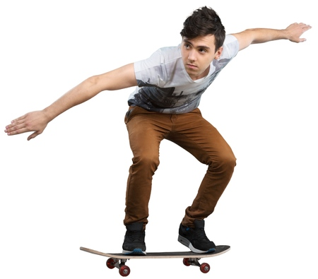 Teenage boy jumping on skateboard isolated on white