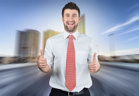 happy businessman with big head showing two thumbs up and laughing. funny picture over dark background 스톡 콘텐츠