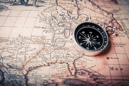 old compass on a map Stock Photo