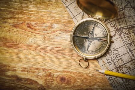 old map and compass on a wooden table Stock Photo - 104444315