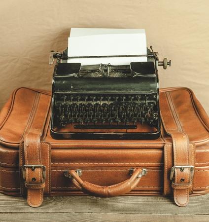 Typewriter and vintage suitcase