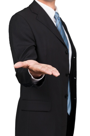 Man wearing a business suit reaching hand out