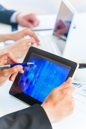Close-up of female hands during work with touchpad Stock Photo