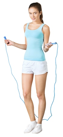 Young beautiful sporty woman  with jumping rope