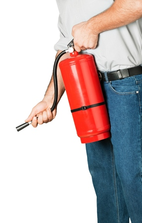 Man using fire extinguisher against grey background Stock Photo