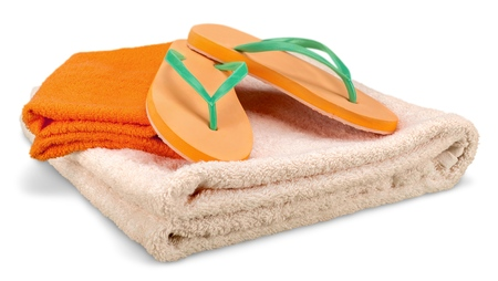 Rubber sandals flip flops and towels isolated on white Stock Photo