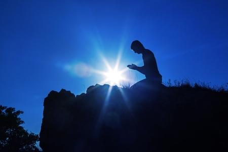 Man Praying Against Sun