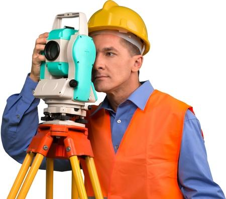 Portrait of a Land Surveyor Working with Modern Theodolite