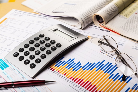 Business Graphs and Charts with Calculator and Magazines