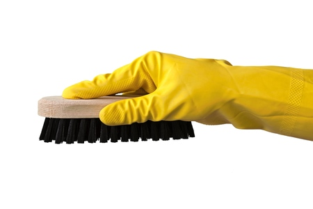 Yellow cleaning glove with a brush isolated on white Stock Photo