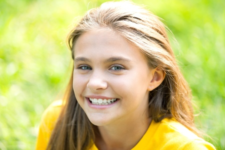 Portrait of a Smiling Girl Stock Photo