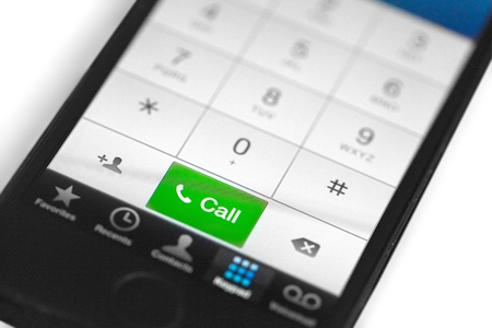 Close-up of iPhone Call on Keypad Stock Photo