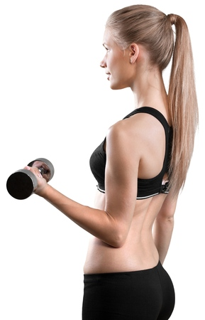 Female fitness model wearing a sports bra and holding a dumbbell