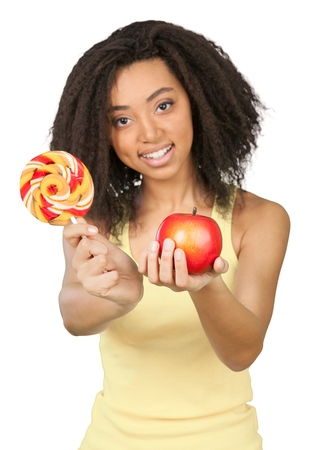 Young beautiful woman with red apple isolated on white background
