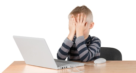 Young boy frustrated with computer Stock Photo