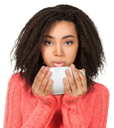 Woman with tea cup in hands isolated on white