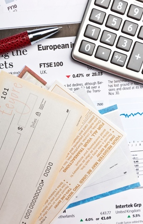 Blank Check Templates, Pen And Calculator On Financial Report Close-up Stock Photo