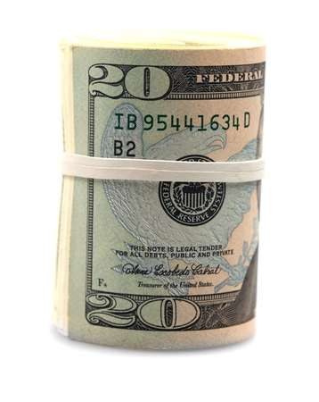 Roll of twenty dollar bills wrapped in a rubber band Stock Photo