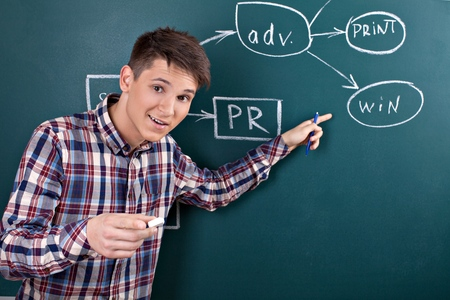 Man Presenting on Blackboard His Idea of How to Win Stock Photo